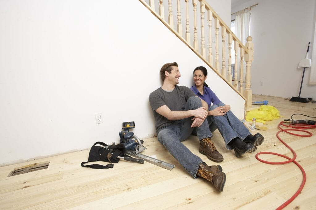 Two people inside a house