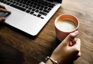 A laptop and a mug with coffee