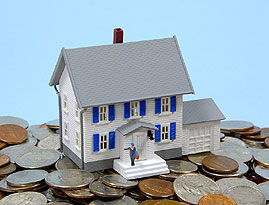 Coins surrounding a model house