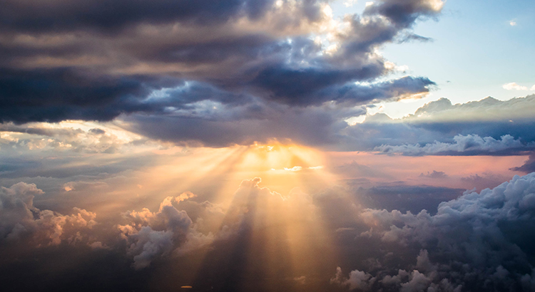 The sun's rays and some clouds